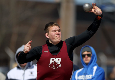 Sarah Nader - snader@shawmedia.com Prairie Ridge's Josh Behning competes in shot put during Saturday's McHenry County Track Meet at Cary-Grove High School on April 20, 2013.