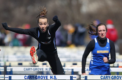 Sarah Nader - snader@shawmedia.com McHenry's Macy Glosson competes in the 100m hurdles   during Saturday's McHenry County Track Meet at Cary-Grove High School on April 20, 2013.