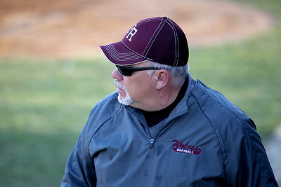 Sarah Nader - snader@shawmedia.com Prairie Ridge's softball head coach Mike Buck watched his team during a game against Woodstock North in Crystal Lake on Monday, April 8, 2013.