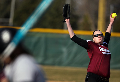 Sarah Nader - snader@shawmedia.com Prairie Ridge's Kirsten Stevens pitches during Monday's game against Woodstock North in Crystal Lake on April 8, 2013. Prairie Ridge won, 4-1.