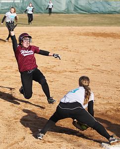 Sarah Nader - snader@shawmedia.com Prairie Ridge's Kate Didier is out as she dives into third base during the fourth inning of Monday's game against Woodstock North in Crystal Lake on April 8, 2013. Prairie Ridge won, 4-1.