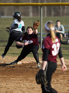 Sarah Nader - snader@shawmedia.com Woodstock North's Kristin Brenner is out at first when Prairie Ridge's Maddie Drain catches the pass during the fifth inning of Monday's game in Crystal Lake on April 8, 2013. Prairie Ridge won, 4-1.