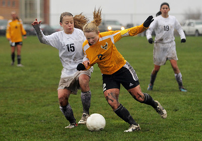 Sarah Nader - snader@shawmedia.com Prairie Ridge's Mariah Truitt (left) and Jacobs' Kylie Dennison battle for control of the ball during the second half of Tuesday's rain-shortened soccer game in Crystal Lake on April 23, 2013. Prairie Ridge won, 4-0.