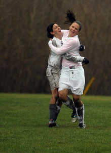 Sarah Nader - snader@shawmedia.com Prairie Ridge's Shannon Patinella (left) and Ashtynn Trauth celebrate Trauth's goal in the second half of Tuesday's soccer game against Jacobs in Crystal Lake on April 23, 2013. Prairie Ridge won, 4-0.