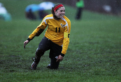 Sarah Nader - snader@shawmedia.com Jacobs' Margaret Rivera slips in the mud during the first half of Tuesday's rain-shortened soccer game in Crystal Lake on April 23, 2013. Prairie Ridge won, 4-0.