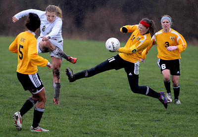 Sarah Nader - snader@shawmedia.com Jacobs' Margaret Rivera (right) tries to stop a ball kicked by Prairie Ridge's Jordan Reitz during the first half of Tuesday's rain-shortened soccer game in Crystal Lake on April 23, 2013. Prairie Ridge won, 4-0.