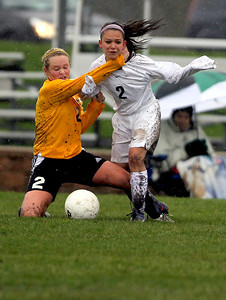 Sarah Nader - snader@shawmedia.com Jacobs' Kylie Dennison left takes down Prairie Ridge's Larissa Dooley during Tuesday's rain-shortened soccer game in Crystal Lake on April 23, 2013. Prairie Ridge won, 4-0.