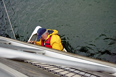 Monica Maschak - mmaschak@shawmedia.com   Albert Roehrig, with the Three Oaks Recreation Area, guides a row boat under a bridge on Friday, April 12, 2013 in preparation for opening weekend of Marina Rentals on Saturday, April 13. Three Oaks will offer row boats with trollingmotors, canoes, kayaks and paddleboats.