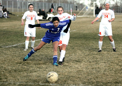 Monica Maschak - mmaschak@shawmedia.com Dundee-Crown's Franki Scarpelli attempts to block Crystal Lake Central's Natalie DellaMaria from getting to the ball during a game at Central on Tuesday, April 2, 2013. The Tigers won 4-3.
