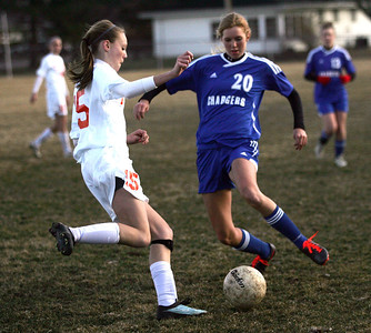 Monica Maschak - mmaschak@shawmedia.com Crystal Lake Central's Olivia Hollander and Dundee-Crown's Jill Wiechmann both wind up to kick the ball during a Crystal Lake Central home game on Tuesday, April 2, 2013. The Tigers won 4-3.