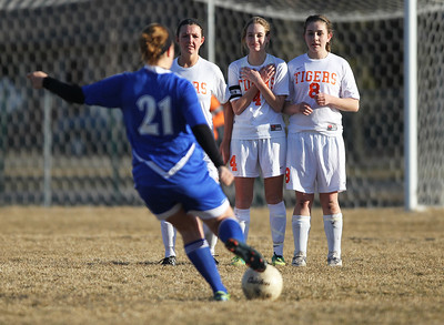 Monica Maschak - mmaschak@shawmedia.com Crystal Lake Central players line up to block a scoring attempt by Dundee-Crown's Brittney Gantz in the second half of Tuesday's game. The Tigers won 4-3.