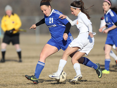 Monica Maschak - mmaschak@shawmedia.com Crystal Lake Central's Stacie Wolfgram goes in to steal the ball from Dundee-Crown's Brittney Gantz during a game at Central on Tuesday, April 2, 2013. The Tigers won 4-3.
