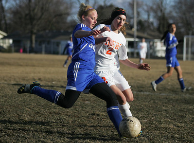 Monica Maschak - mmaschak@shawmedia.com Dundee-Crown's Carson Bloch and Crystal Lake Central's Riley Hudak battle for possesion of the ball during a Crystal Lake Central home game on Tuesday, April 2, 2013. The Tigers won 4-3.