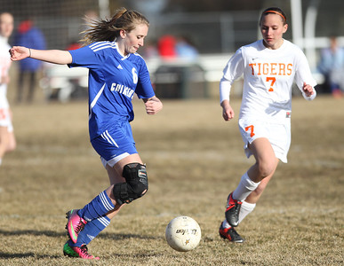 Monica Maschak - mmaschak@shawmedia.com Dundee-Crown's Shannon Feld races down the field followed by Crystal Lake Central's Morgan Bertalon in Tuesday's game. The Tigers won 4-3.