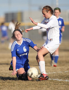 Monica Maschak - mmaschak@shawmedia.com Dundee-Crown's Shannon Feld falls as she collides with Crystal Lake Central's Morgan Bertalon in a fight for possesion on Tuesday, April 2, 2013. The Tigers won 4-3.