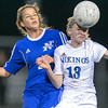 Geneva's Megan Newingham (13) goes up for a header against St. Charles North's Lizze Parrilli at Geneva High School in Geneva, IL on Tuesday, April 09, 2013  (Sean King for Shaw Media)