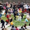 Children ages 3 to 4-years-old gather eggs during Saturday's Easter egg hunt at Mooseheart.<br /> (Jeff Krage for Shaw Media)