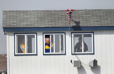 Candace H. Johnson Johnsburg's Tom Ross, athletic director and announcer, (center) gets a better view from the press box to watch the Johnsburg girls varsity soccer team play against Mundelein during the Lady Hawk Invite at Johnsburg High School.