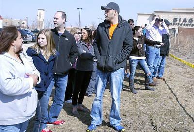 Bystanders watch as fire department crews arrive at Algonquin Commons. H. Rick Bamman - hbamman@shawmedia.com