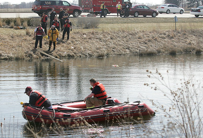 H. Rick Bamman - hbamman@shawmedia.com  Firefihters use sonar to check the pond after a  car plunged into the water at Corporate Drive and Randall Road in Algonquin on Wednesday, April 2, 2014.