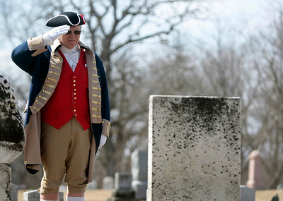 Michelle LaVigne/ For Shaw Media Bob Collins, the Illinois State President for the Children of the American Revolution salutes the grave of  Revolutionary War soldier Major Watson inside of the Linn-Hebron Cemetery in Hebron on April 6, 2014. Collins participated in a dedication ceremony inside of Linn-Hebron after a plaque was erected explaining the life of Major Watson, and identifying the burial of a Revolutionary soldier inside of Linn-Hebron.
