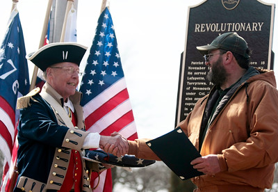 Michelle LaVigne/ For Shaw Media Bob Collins, the Illinois State President for the Children of the American Revolution (left,) thanks Linn-Hebron Cemetery sexton Tom Evers for his help in securing a plaque in honor of Revolutionary War soldier Major Watson during a dedication ceremony for the plaque on Sunday, April 6th, 2014. The Sons of the American Revolution is seeing to it that graveyards across Illinois are marked with a plaque showing they have a Revolutionary Patriot buried inside.