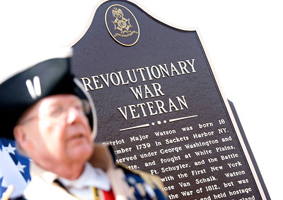 Michelle LaVigne/ For Shaw Media Bob Collins, the Illinois State President for the Children of the American Revolution, speaks about the importance of preserving history during a dedication at the Linn-Hebron Cemetery in Hebron on Sunday, April 6th, 2014. Behind him is the recently established plaque honoring Revolutionary War soldier Major Watson. Sons of the American Revolution are seeing to it that graveyards across Illinois are marked with a plaque showing they have a Revolutionary Patriot buried inside. Linn-Hebron Cemetery in Hebron is the resting spot for Major Watson.