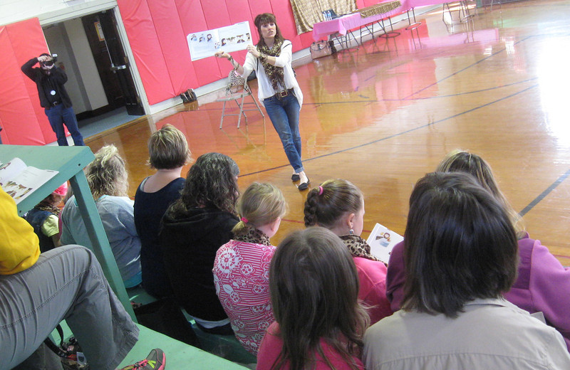 "Author Amy Logan reads her first book, ""A Girl With A Cape,"" to a group of mothers and daughters Sunday during the Empowering Girls to Be Super event in the Sugar Grove Community Center."