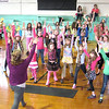 Kristen Desler instructs girls on yoga techniques Sunday during the Empowering Girls to Be Super event in the Sugar Grove Community Center.