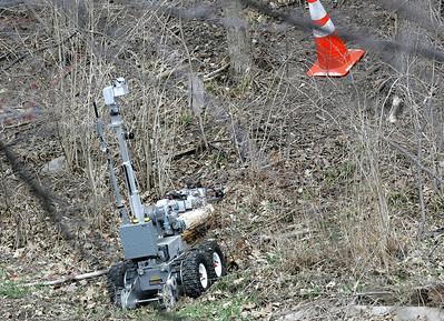 H. Rick Bamman - hbamman@shawmedia.com  A Kane County Bomb Squad robot works the scene.