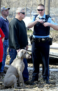 "H. Rick Bamman - hbamman@shawmedia.com  Home owner Timothy Goorsky leads his to dogs a way from flames as his burn on Wednesday, April 9, 2014. The family lost two cats. ""We loved them and will miss them,"" Goorsky said."