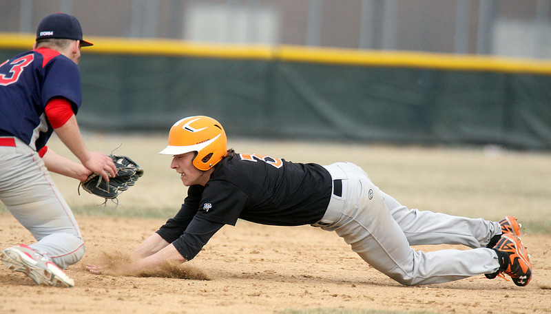 Jeff Krage – For Shaw Media<br /> St. Charles East's Austin Regelbrugge is tagged out by South Elgin second baseman Zach Filippo while attempting to steal second base during Thursday's game in South Elgin.<br /> South Elgin 4/10/14