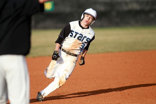 St. Charles North's Jake Jozefowicz rounds third base during their home game against Neuqua Valley Friday.