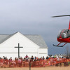 Jeff Krage – For Shaw Media<br /> A helicopter carrying the Easter Bunny lands for Saturday's egg hunt at Faith Baptist Mill Creek in Geneva.<br /> Geneva 4/12/14