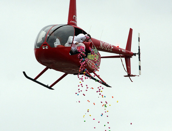 Jeff Krage – For Shaw Media<br /> The Easter Bunny drops eggs from a helicopter during Saturday's egg hunt at Faith Baptist Mill Creek in Geneva.<br /> Geneva 4/12/14