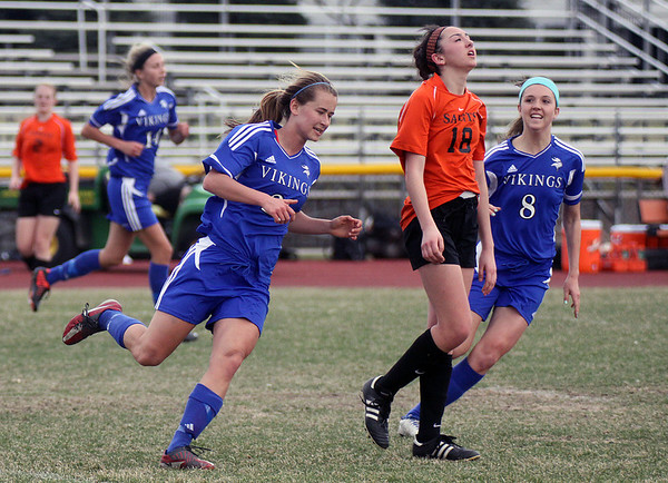 Jeff Krage – For Shaw Media<br /> St. Charles East's Mallory Mollenhauer (#18) shows her disappointment after Geneva's Mary Landry (center) scores the first goal of the game late in the first half during Saturday's Augsburg Drach Invitational at St. Charles East High School.<br /> St. Charles 4/12/14