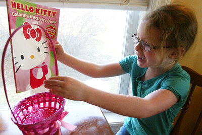 H. Rick Bamman - hbamman@shawmedia.com Six-year-old Ali VanDermey packs one of 15 Easter baskets she will deliver Friday to children at Rockford Memorial Hospital.