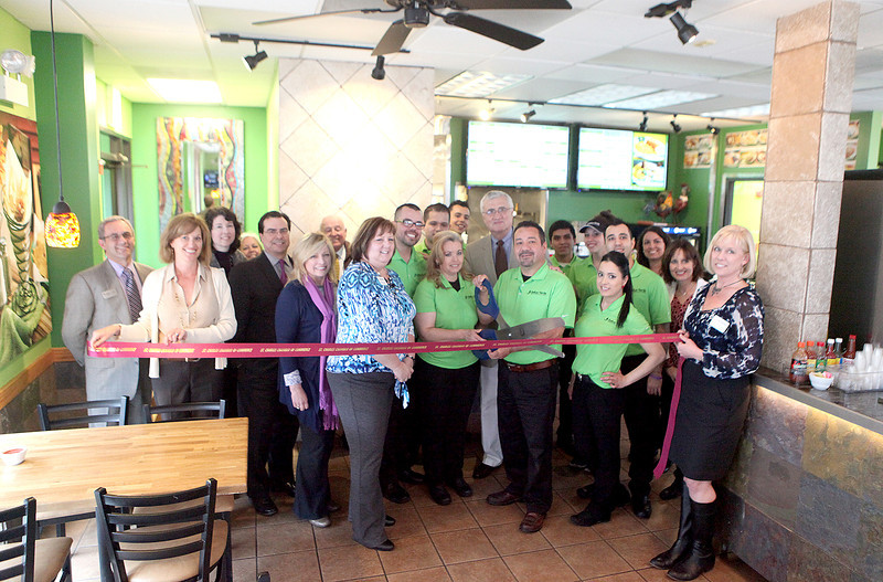 Carmen and Clemente Arechiga (center), along with their family, are joined by St. Charles Chamber of Commerce and City of St. Charles officials to cut the ribbon for Salsa Verde Mexican Restaurant. Salsa Verde is located at 1850 Lincoln Highway in St. Charles.