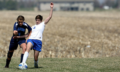 John Konstantaras-for Shaw Media Johnsburg's Shaylah Pegues (3) and Rockford Guilford's (4) fight for a ball during the second half of their game during the Johnsburg Soccer Tournament at Johnsburg High School Friday, April 18, 2014. The Skyhawks won the game 7-1.