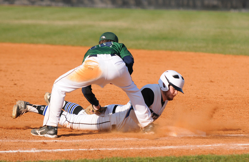 North Star Jack Dennis dives into first base safely on a  pick-off attempt during SCN's 3-2 home victory over Bartlett on Friday.