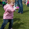 Karen Naess For The Kane County Chronicle<br /> Addison Bakker 19 months old from Batavia runs with her egg during the first ever Batavia Easter egg hunt on Saturday.
