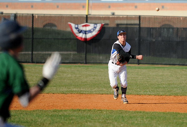 St. Charles North shortstop Zach Mettetal throws out a runner on Friday during his team's 3-2 home victory over Bartlett.