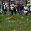 Kid's hurry to gather the eggs during the first ever Batavia Easter egg hunt on Saturday.