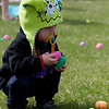 Caden Montalvo 19 months old from Aurora finds two eggs during the first ever Batavia Easter egg hunt on Saturday.