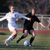 Jeff Krage – For Shaw Media<br /> St. Charles North's Danielle Noverini and St. Charles East's Anna Corirosi battle for the ball during Tuesday's game.<br /> St. Charles 4/22/14