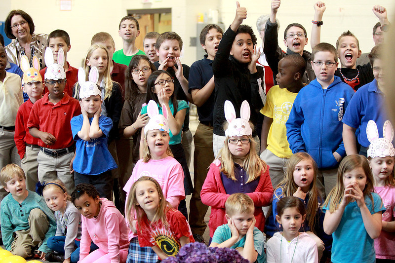 Students at Faith Christian School in Geneva cheer on Daisy the rabbit during a race between a rabbit and a tortoise Thursday as part of their lesson on Aesop's fable, The Tortoise and the Hare.