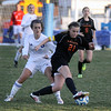 Jeff Krage – For Shaw Media<br /> St. Charles East's Amanda Hilton is defended by St. Charles North's Danielle Noverini during Tuesday's game.<br /> St. Charles 4/22/14
