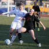 Jeff Krage – For Shaw Media<br /> St. Charles North's Alyssa Brandt and St. Charles East's Kelli Santo Paulo battle for the ball during Tuesday's game.<br /> St. Charles 4/22/14