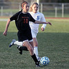 Jeff Krage – For Shaw Media<br /> St. Charles East's Mallory Mollenhauer advances the ball during Tuesday's game at St. Charles North.<br /> St. Charles 4/22/14