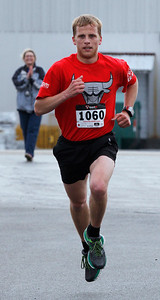 Curtis Weissenburger, from McHenry, heads to the finish line to win the Human Race 5K run Sunday, April 27, 2014 in McHenry. The race is a unique 5K that supports over 50 charities serving McHenry County IL. Each race participant designates what organization will receive the proceeds of their race fee.  John Konstantaras photo for the Northwest Herald